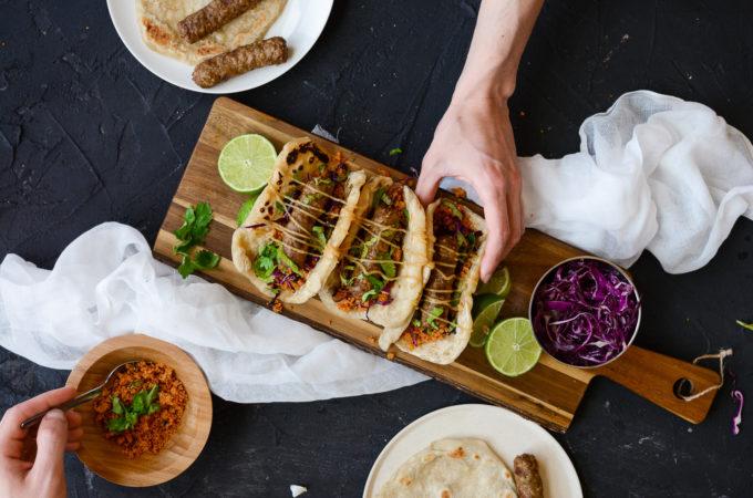 Cevapcici Flatbread Tacos with a Lime Tahini Drizzle